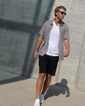 White Canvas Low Top Sneakers Outfits For Men: If you're looking for a relaxed casual and at the same time seriously stylish getup, go for a grey short sleeve shirt and black shorts. We love how complete this outfit looks when completed with a pair of white canvas low top sneakers.