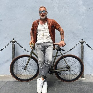 How to Wear White Leather High Top Sneakers For Men: Go for a dark brown short sleeve shirt and grey skinny jeans if you're on the hunt for an outfit idea for when you want to look casual and cool. If you're on the fence about how to finish, a pair of white leather high top sneakers is a foolproof option.