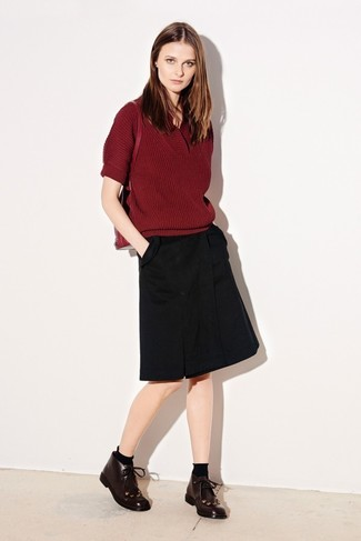 How to wear: burgundy short sleeve sweater, black a-line skirt, burgundy leather desert boots, red leather backpack