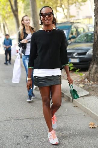 How to wear: black short sleeve sweater, white crew-neck t-shirt, black leather mini skirt, orange athletic shoes