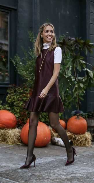 How to wear: white short sleeve sweater, burgundy leather overall dress, burgundy velvet pumps, gold pendant