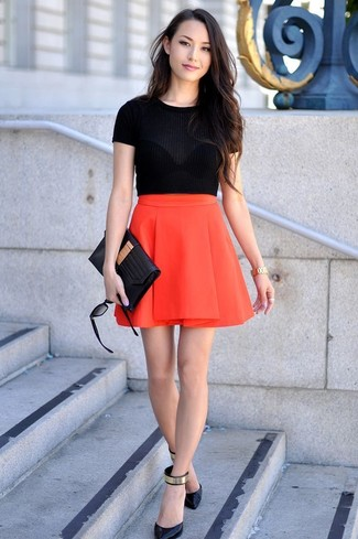 Red Skater Skirt Outfits: This casual pairing of a black short sleeve sweater and a red skater skirt is super easy to pull together in no time, helping you look chic and prepared for anything without spending a ton of time searching through your wardrobe. And if you want to instantly step up your getup with footwear, why not complement this look with a pair of black and gold leather pumps?