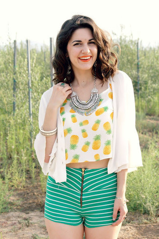 Marry an orange cropped top with green striped shorts for a standout ensemble.