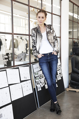 Rock a silver sequin blazer jacket with blue jeans for a glam and trendy getup. Rock a pair of black studded leather booties to va-va-voom your outfit.