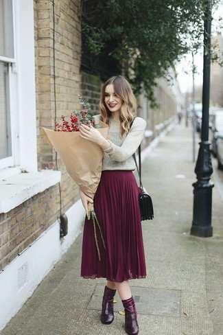 How to wear: silver crew-neck sweater, purple pleated midi skirt, burgundy leather ankle boots, burgundy leather crossbody bag