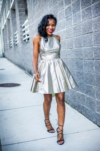 Consider wearing a silver fit and flare dress for a stylish and sophisticated look. To bring out the fun side of you, round off your getup with navy suede gladiator sandals.
