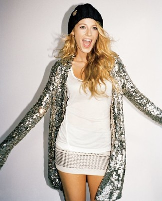 Dress in a metallic sequin open cardigan and a nude sequin mini skirt to achieve a chic look.