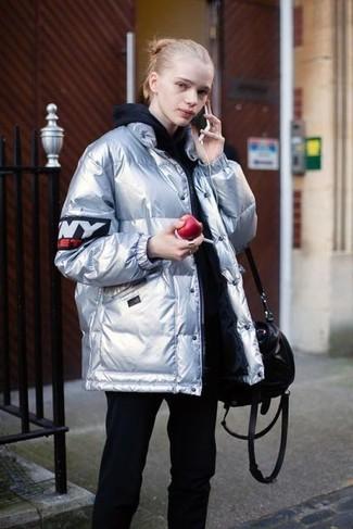 How to wear: silver puffer jacket, black hoodie, black sweatpants, black leather tote bag