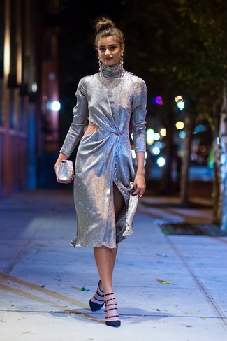 Consider wearing a silver cutout sheath dress for a casual level of dress. As for the shoes, rock a pair of black suede pumps. It's is a good idea if you're piecing together a knockout summer-to-fall look.