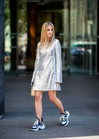 How to wear: silver shift dress, blue athletic shoes, beige quilted leather clutch