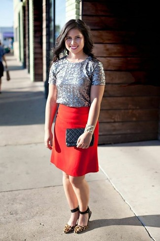 This combination of a silver sequin short sleeve blouse and a J.Crew Pencil Skirt In Super 120s Wool will set you apart effortlessly. Complement your outfit with tan leopard suede pumps. This here is proof that you totally can survive the crazy heat, all while looking light and breezy.