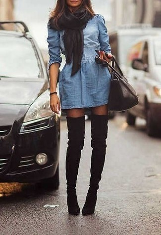 How to Wear Black Tights: A blue denim skater dress and black tights are a combination that every chic girl should have in her off-duty styling lineup. Complement your getup with black suede over the knee boots to make the getup a bit dressier.