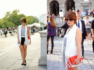 This pairing of a white sleeveless blazer and black and white shorts combines comfort and functionality and allows you to keep it clean yet current. Let's make a bit more effort now and opt for a pair of black suede pumps. So if you're in search of an insta-worthy outfit on a hot day, look no further.