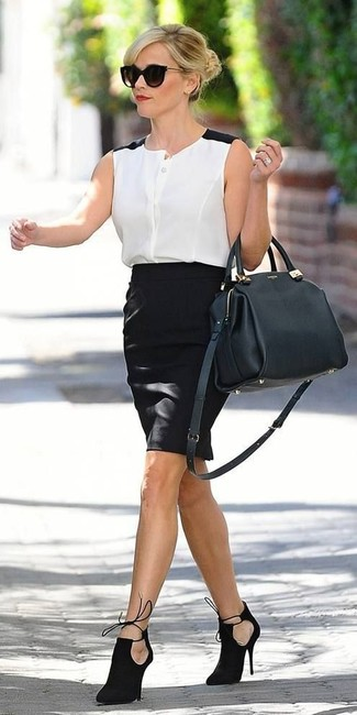 Reese Witherspoon wearing White and Black Chiffon Sleeveless Button Down Shirt, Black Pencil Skirt, Black Cutout Suede Ankle Boots, Black Leather Satchel Bag
