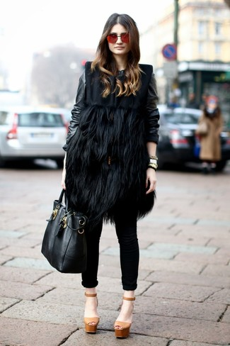 How to wear: black fur sleeveless coat, black leather bomber jacket, black skinny jeans, tan chunky leather heeled sandals
