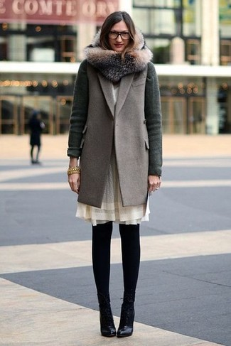 How to wear: grey sleeveless coat, dark green cardigan, beige chiffon shift dress, black leather ankle boots