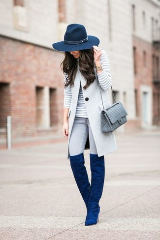 How to wear: grey sleeveless coat, grey horizontal striped crew-neck sweater, grey skinny jeans, blue suede over the knee boots