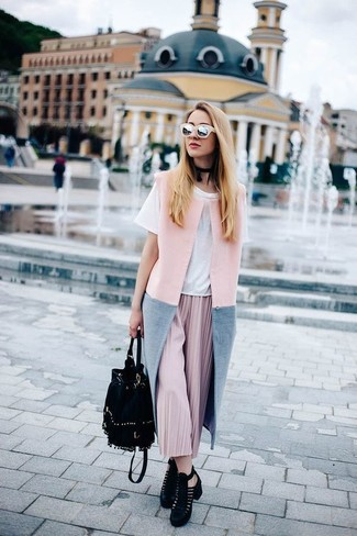 How to wear: pink sleeveless coat, white crew-neck t-shirt, pink pleated midi skirt, black cutout suede ankle boots