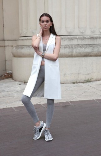 How to wear: white sleeveless coat, grey cropped top, grey leggings, grey athletic shoes