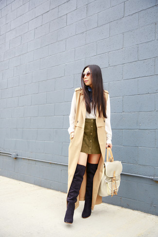 Dress in a camel sleeveless coat and a button skirt for a refined yet off-duty ensemble. Complete this getup with black suede over the knee boots. Loving that this combination is great when warmer days are here.