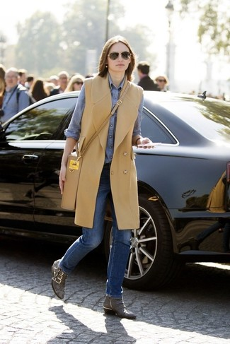 How to wear: camel sleeveless coat, blue chambray dress shirt, blue jeans, grey snake leather ankle boots