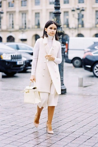 How to Wear a White Turtleneck For Women: For a relaxed casual outfit with a twist, choose a white turtleneck and white culottes. To bring some extra oomph to this ensemble, introduce a pair of beige suede pumps to the mix.