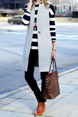 How to wear: grey sleeveless coat, white and black horizontal striped turtleneck, black skinny jeans, tobacco leather chelsea boots
