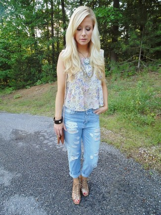Try pairing a grey floral chiffon sleeveless top with baby blue destroyed boyfriend jeans for comfortdressing from head to toe. Polish off the ensemble with gold leather wedge sandals. The ease and comfort of this getup takes care of the heat and helps you make a sartorial statement wherever you go.