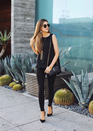 How to wear: black sleeveless top, black leggings, black suede pumps, black quilted leather crossbody bag