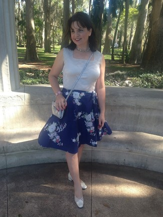 How to wear: silver sleeveless top, blue floral midi skirt, white leather pumps, silver leather crossbody bag