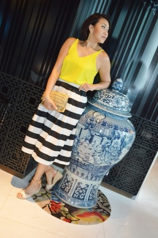How to wear: yellow sleeveless top, white and black horizontal striped midi skirt, beige leather wedge sandals, tan straw clutch