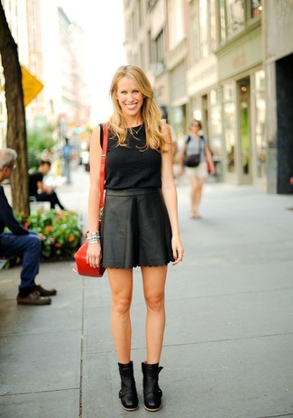 How to wear: black sleeveless top, black leather mini skirt, black leather ankle boots, red leather crossbody bag