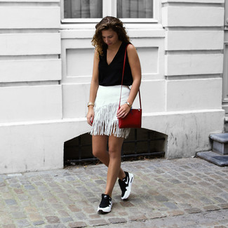 How to wear: black sleeveless top, white fringe mini skirt, black and white athletic shoes, red leather crossbody bag