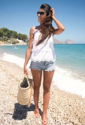 Rock a white crochet sleeveless top with light blue denim shorts for a casual level of dress. This ensemble is complemented perfectly with beige rubber ballerina shoes. As this combination shows, you can't think of a better pick for warm weather.
