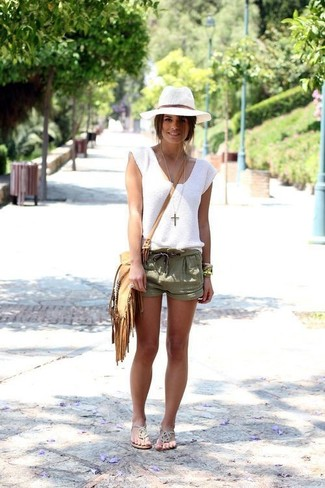 How to wear: white sleeveless top, olive shorts, silver thong sandals, tan fringe crossbody bag
