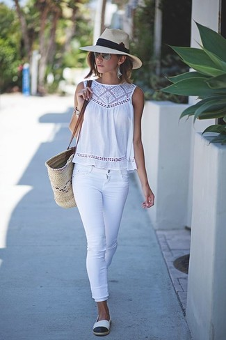 How to wear: white crochet sleeveless top, white skinny jeans, white and black espadrilles, beige straw tote bag