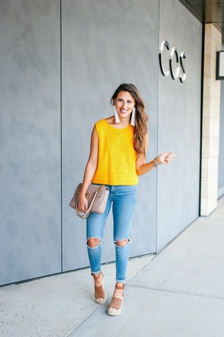 Choose a yellow knit sleeveless top and light blue ripped skinny jeans for an effortless kind of elegance. Round off this look with brown suede wedge sandals.