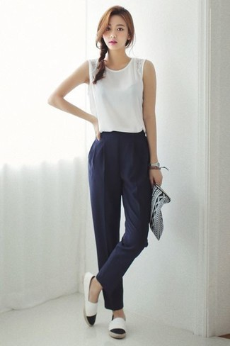 How to wear: white sleeveless top, navy tapered pants, white and black espadrilles, black and white print leather clutch