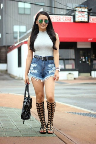 For an outfit that provides comfort and chicness, team a grey sleeveless turtleneck with a Fossil Studded Leather Belt. Grab a pair of black leather knee high gladiator sandals to make the getup current. This outfit is great when it's extremely hot outside.