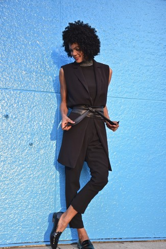 Black Leather Loafers Outfits For Women After 40: When the setting allows a casual getup, you can go for a black sleeveless turtleneck and black skinny pants. Let your styling prowess really shine by complementing this look with a pair of black leather loafers.
