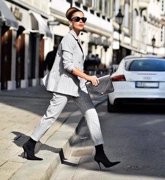 How to wear: grey plaid suit, black elastic ankle boots, black leather clutch, black sunglasses