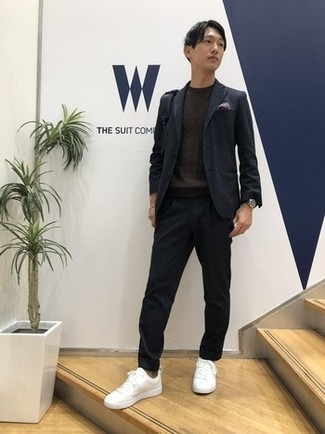 Cable Sweater Outfits For Men: Try pairing a cable sweater with a charcoal wool suit to be the picture of polish. Complement this outfit with white canvas low top sneakers to give an air of stylish casualness to this getup.