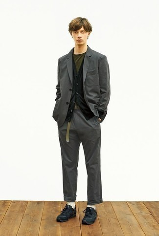 Charcoal Suit Outfits: Choose a charcoal suit and a black cardigan to look like a true fashion visionary. To give your overall outfit a more relaxed aesthetic, why not add a pair of black athletic shoes to this getup?
