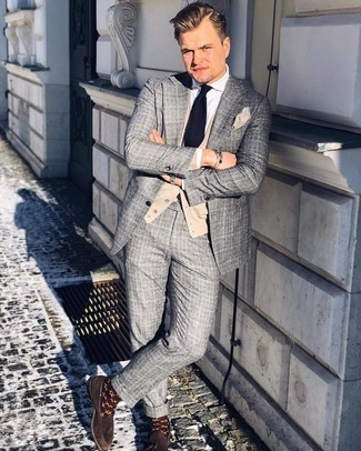 Beige Cardigan Outfits For Men: You're looking at the irrefutable proof that a beige cardigan and a grey plaid suit look amazing when married together in a sophisticated ensemble for a modern guy. Tap into some David Gandy stylishness and complete this getup with a pair of dark brown suede tassel loafers.