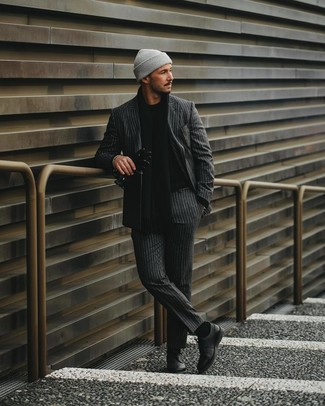 How to wear: charcoal vertical striped suit, black crew-neck sweater, black leather derby shoes, grey beanie