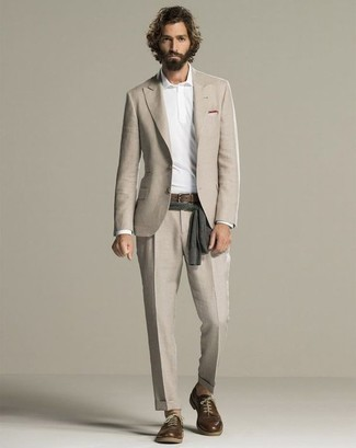 How To Wear a Suit With a Polo Neck Sweater: Combining a suit with a polo neck sweater is a good pick for a smart and classy look. Inject a sense of stylish casualness into this ensemble by finishing off with a pair of dark brown leather derby shoes.