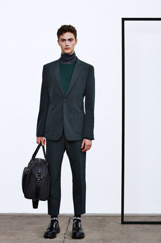 How to wear: charcoal suit, dark green crew-neck sweater, charcoal turtleneck, black leather derby shoes