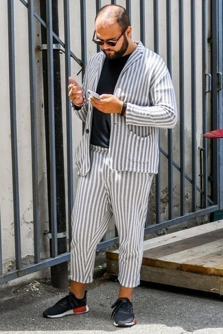 How to Wear a White Vertical Striped Suit: A white vertical striped suit and a black crew-neck t-shirt are among those sport-anywhere-anytime pieces that have become the key elements in any modern gent's wardrobe. A nice pair of black athletic shoes is an effortless way to give a touch of stylish casualness to your getup.