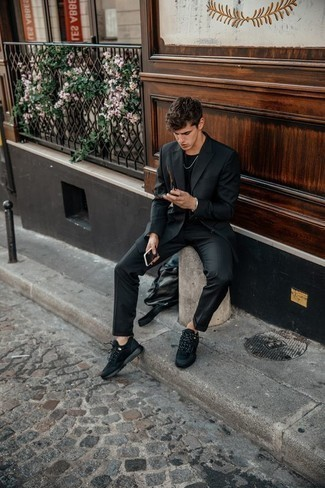 Black Leather Backpack Outfits For Men: This pairing of a black suit and a black leather backpack is on the off-duty side yet it's also dapper and incredibly stylish. Inject a more relaxed twist into this look by slipping into black athletic shoes.