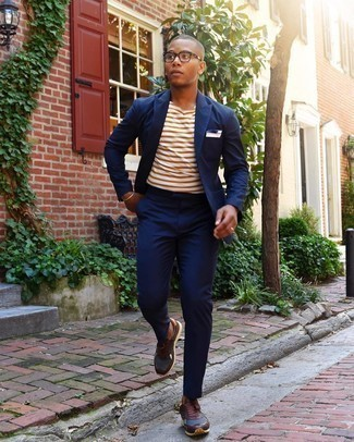 Bracelet Outfits For Men: Try pairing a navy suit with a bracelet for both stylish and easy-to-create outfit. Go the extra mile and jazz up your look by slipping into a pair of dark brown athletic shoes.